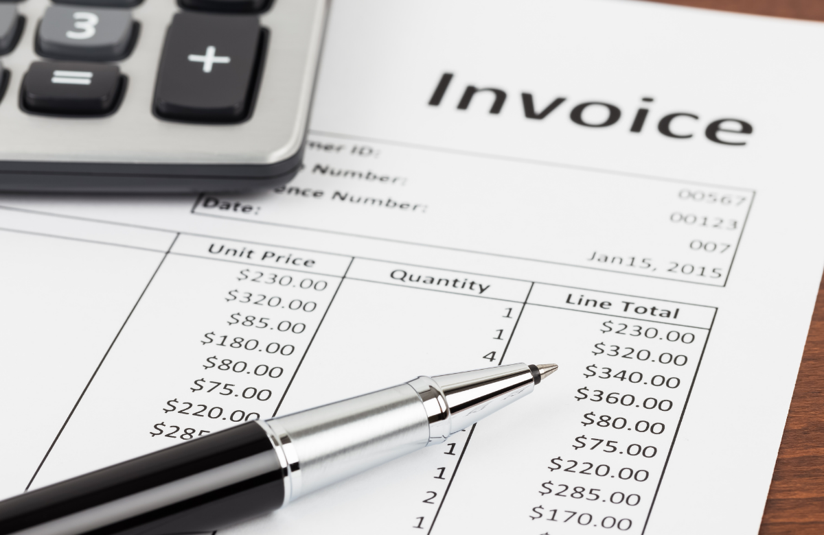 Paper invoice with calculator